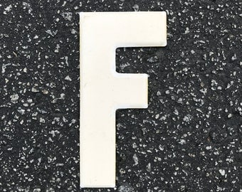 F -- Frankly just a metal letter