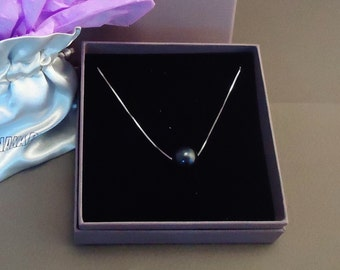 Silver necklace with a floating black freshwater pearl