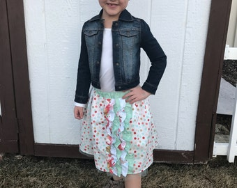 Polka dot skirt with side ruffles and tule at the bottom