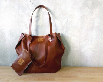 Set of brown leather tote and pouch