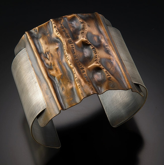 Fold formed silver filled and copper cuff