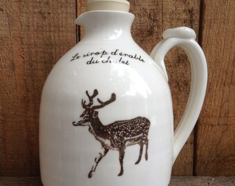 "Jug for maple syrup with a deer and french inscription ""Le Pichet à Sirop du Chalet"""