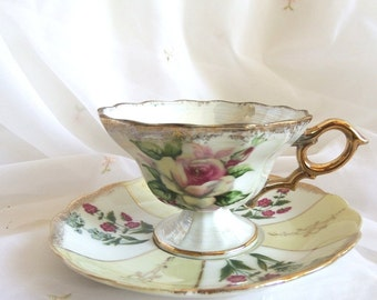 Lusterware Pedestal Teacup and Saucer with Hand Painted Roses and Brushed Gold Accents