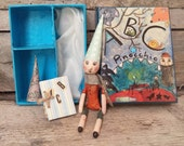 Pinocchio puppet dollhouse box, story box with hand made marionette art doll, scarf and two caps for Pinocchio and an aphabet. Ready to ship