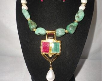 A magnificent 15-Carats Ruby,15 Carats Emerald,5 Carat Garnet Necklace Set******.