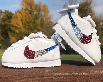 ... Infant and Toddler Red White and Blue Nike Cortez featuring Dozens of  Swarovski Crystals ... b11863f5d