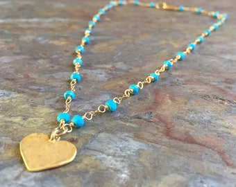 Turquoise gemstone gold necklace with a gold heart charm