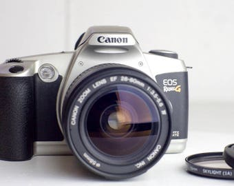 Canon EOS Rebel G 35mm Film SLR Camera with Canon EF Ultrasonic 28-80mm F/3.5-5.6 lV Zoom Lens, Cap, Filter - Fully Functional