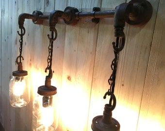 Steel conduit pipe, hanging wall or ceiling mason jar light, finished in sprayed rust finish