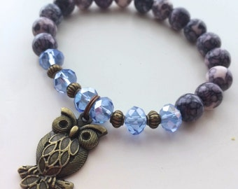 Bracelet of natural pearls with Swarovski stones and OWL charm