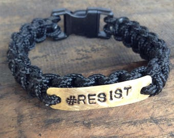 Resist Bracelets, Survival, Knotted Skinny Paracord, Brass Charm, Black Plastic Buckle, White, Black, Rainbow, Hope, Indivisible, #Resist,