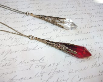 Crystal point filigree pendant necklace in red or clear