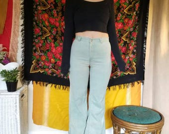 Teal vintage Levi jeans/ size womens 6 flare pants