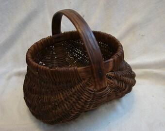 Wonderful antique small buttocks basket