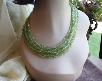 Nine strand peridot designer made necklace