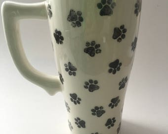 Ceramic travel mug hand decorated with black paw prints, cat, dog
