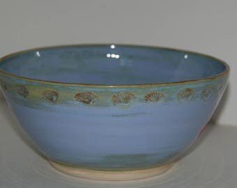 Hand made blue pottery bowl with shells and decoration.