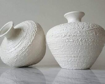 Roy Craft Laurentian Pottery Quebec Canada Set of 2 White Ivory Textured Matte Finish Ceramic Vases Circa 1970 Fat Lava Mid Century Modern