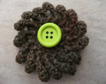 Green and brown crocheted curly flower brooch with large green button