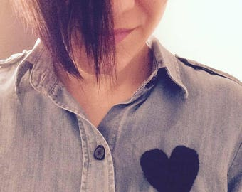 Crocheted black heart brooch.