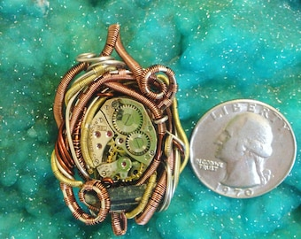 Watch Gear With Kyanite Wire Wrapped Pendant