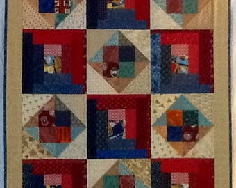 Quilt of log cabin squares and diamonds giving it a rustic feeling.  Great for that little guy's crib, car seat or just to cuddle with.
