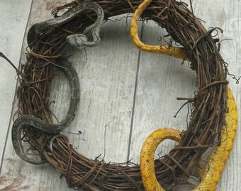 Mummified snake wreath taxidermy art