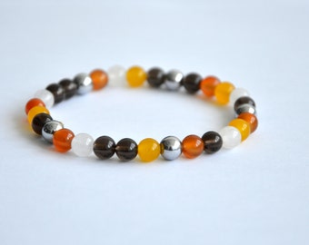 White and yellow jade, orange agathe, hematite and quartz bracelet. 6mm beads.