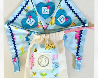 Dinosaurs hand embroidered personalised, fabric bunting in blue and pink custom made flags