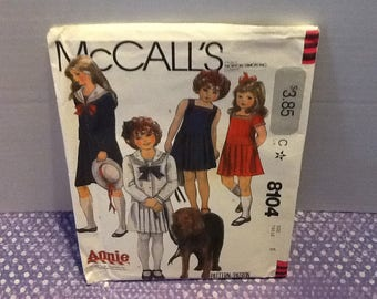 A vintage 1982 McCall's pattern- Annie 8104-6, Annie patterns-Comes with a dress and coast pattern, pleated skirt and sailor coat!