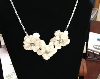 Off white Leather flower necklace with silver chain.