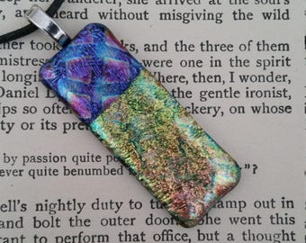 Dichroic glass pendant, With a hatched iridescent top.