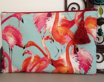 Clutch bag pouch, pink flalands on turquoise background.