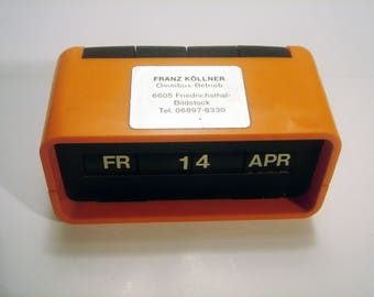 Vintage Perpetual Calendar Orange Color made by ARLAC Switzerland in the 70s