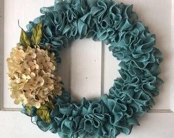 Turquoise Burlap Wreath Accented With Cream Hydrangeas