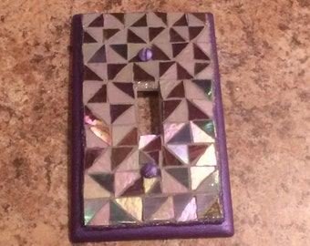 Purple stained glass mosaic light switch plate.