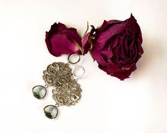 Open-work earrings with crystal pendants