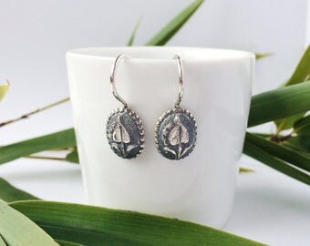 Oxidized silver earrings with a floral pattern, oval, height 10 mm