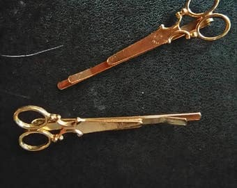 lot of 2 strips of gold color and form scissors