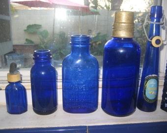 Five Antique Cobalt Blue Bottles