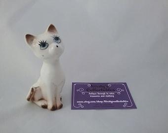 Vintage kitsch cute big eyed cat figurine ornament. Cream and brown cat. Handpainted big eyed figure.