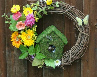 Spring Summer Grapevine wreath. These little birds are looking for a permanent nest.