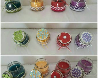 Glass jar with colored scented candles