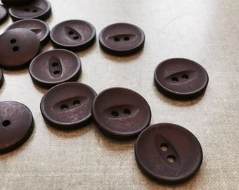Brown plastic buttons. 2cm diameter one dozen