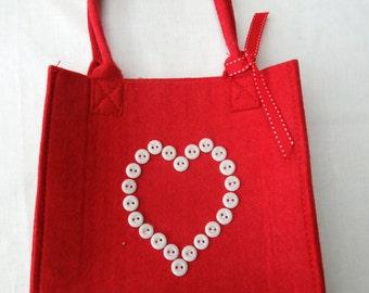 Red felt bag with button heart motif