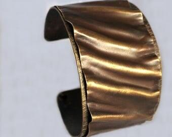 Rippled brass cuff