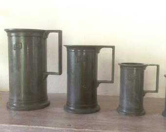 Complete set of 95% PELTRATO pewter measuring cups