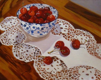 Bowl of cherries and doily