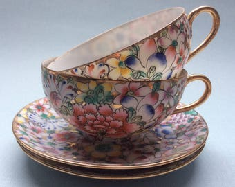 Vintage tea cup and saucer with mille fleur decoration, hand decorated, Japanese porcelain