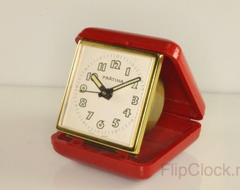 Bright red Prätina foldable travel alarm clock, verrrrry seventies!